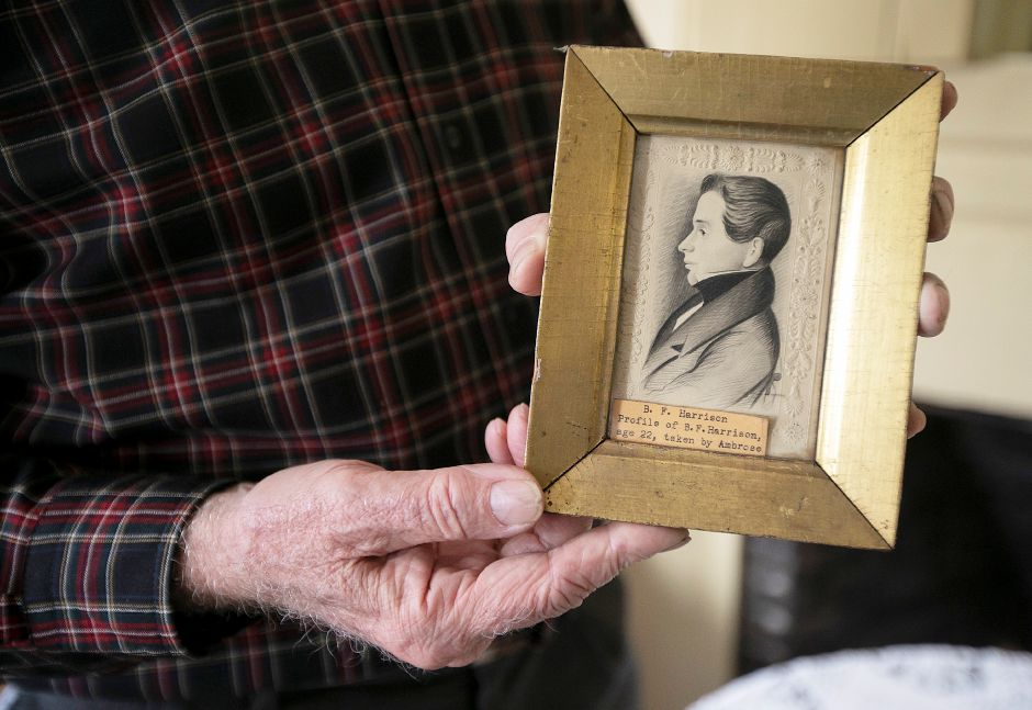 At right, Beaumont holds a framed portrait of Benjamin F. Harrison age 22. Dave Zajac, Record-Journal