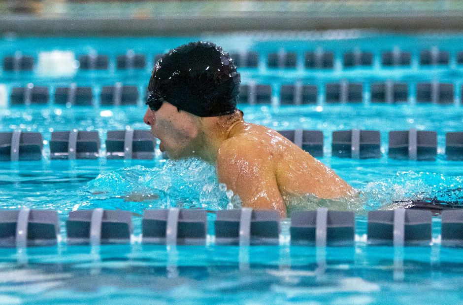 Sheehan senior captain Adam DiDomenico swims the breaststroke leg of the 200 IM against Cheshire during a regular-season dual meet. Also a sprinter, DiDomenico placed third in the 50 freestyle at the SCC Championships. Aaron Flaum, Record-Journal