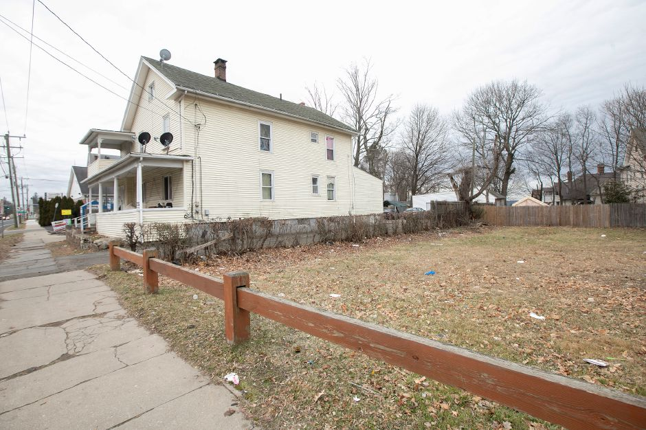 A house at 554-556 Broad St. in Meriden, Fri., Jan. 10, 2020. The house will be razed to become a parking lot for the new location of Tacos Mi Nacho in the vacant lot next door. Dave Zajac, Record-Journal