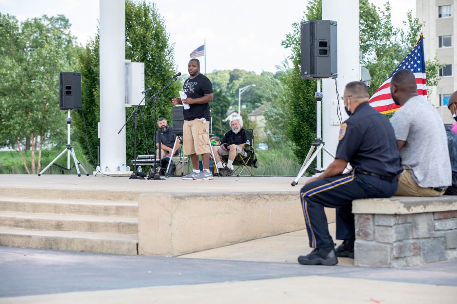 Meriden resident Wilton Carraway speaks at an Sunday, August 9, 2020 rally held on the Meriden Green. Carraway said he supports officers who wear the shield with dignity. He believes there are officers who do the job well and others who do not. | Devin Leith-Yessian/Record-Journal