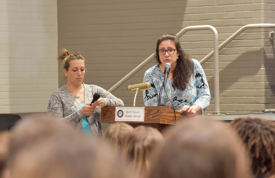 North Haven Middle School teachers Krista Kaplan and Alicia Crismale introduce Holocaust survivor Judith Altmann to eighth-grade students on May 24, 2019. | Bailey Wright, Record-Journal