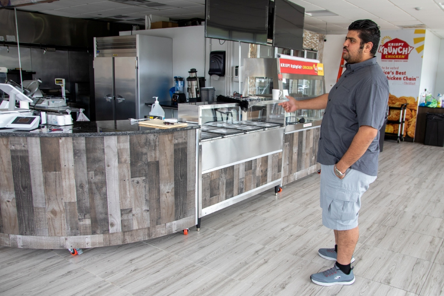 H&T Deli owner Taha Altareb shows his deli area and the Krispy Krunchy Chicken area at Meriden Commons I. Wednesday, September 9, 2020. There is a planned soft opening on Tuesday, September 15, 2020. Aaron Flaum, Record-Journal