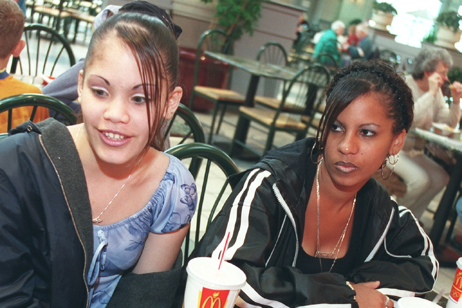 Yeilian Merced, left, 15,and her friend Shirley Mills, 14, both from Meriden, eat together in the Westfield Shoppingtown in Meriden April 27, 2000.